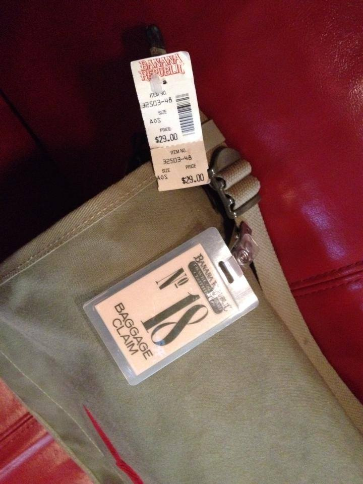 I display it with an authentic bag-check tag I bought from a shopper who nabbed it from one of the Manhattan locations.